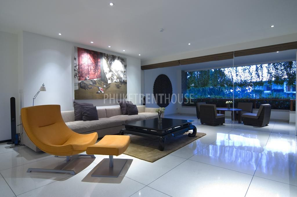 A Unique Living Room With Modern Furniture And A Large HDTV Built Into The  Wall.