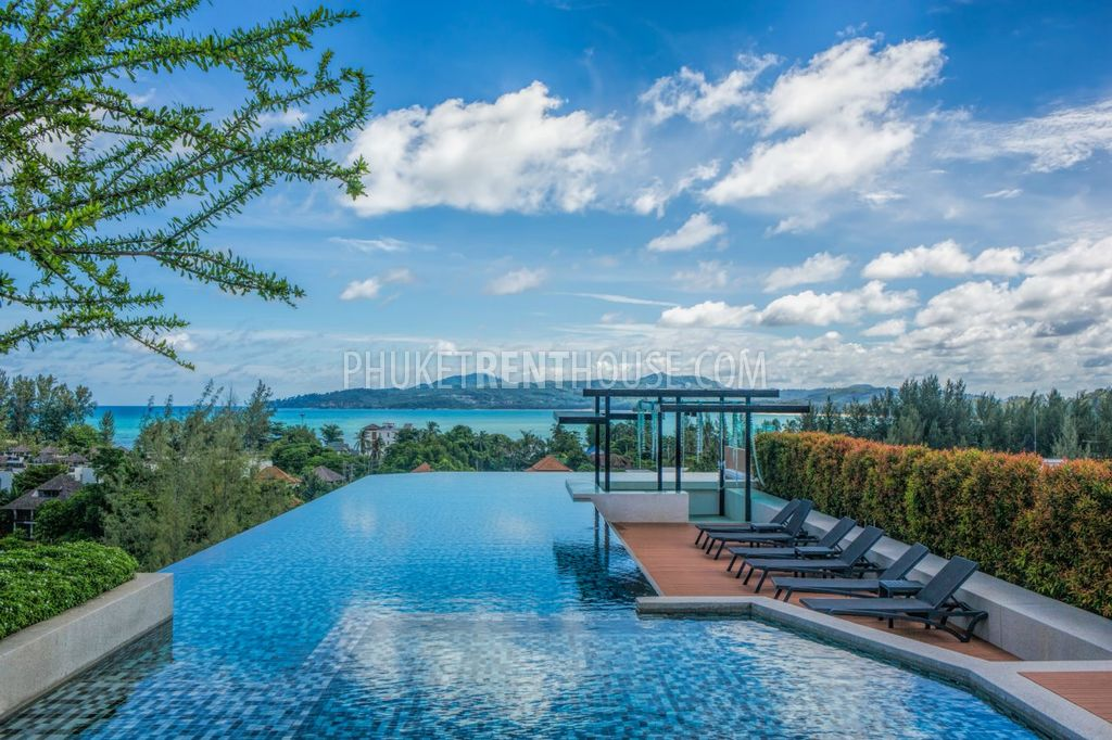 Infinity swimming pool on the roof top with the stunning mountain sea views
