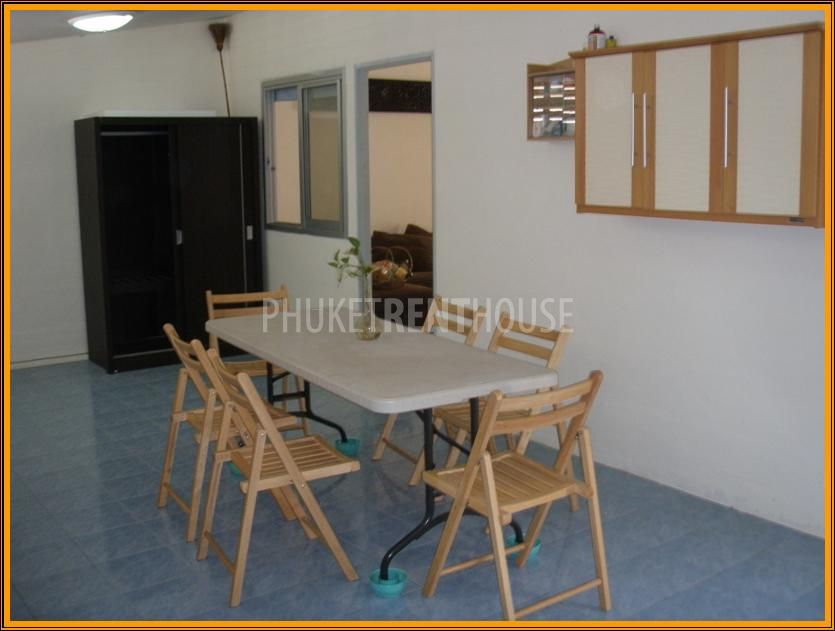 very big kitchen area- dining table with 6 seats- 3 cupboards (1 hanging and 2 on the floor)- first aid box- dish washing sink- refrigerator- washing machine- cloth cabinet for bedroom 1