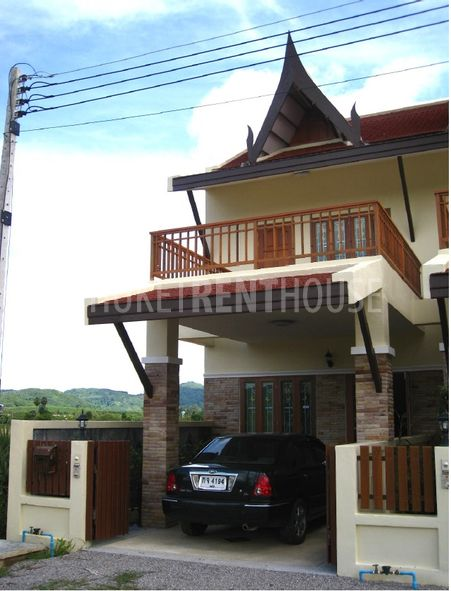 Font of home with private parking and large balcony