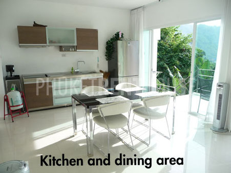 Kitchen and dining area, in the background you have the balcony