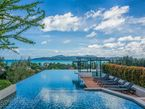 Infinity swimming pool on the roof top with the stunning mountain & sea views