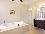 Master Bathroom with large bath, shower and twin basins...