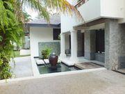 Surin Seven Villa - Outer Courtyard / Koi Pond