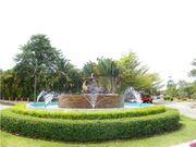 Quiet, wide roadway , green garden in sinsuk thani