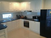 Modern european style kitchen with all amenities. A washing machine for clothes.