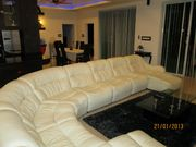 (Pool facing) living room 9 seated leather suite with 60in TV ,dvd. surround sound. Internet and Wi-Fi .AC POINTS AND FANS also bar