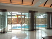 Living area alongside the pool.