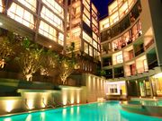 Modern condo with neon lit swimming pool