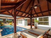 Sunbeds near pool