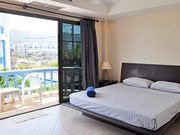 2302 king sized bed with pool view balcony