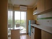 A glass dinnig table,2 lovely designed white chairs, microwave, fridge, cook top, cook hood, sink.