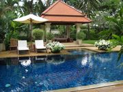 The swimming pool, with sun lounges and a sala to relax in all day.