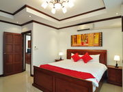 Bed room 1 with Thai Modern decoration providing TV, Closet and safety box