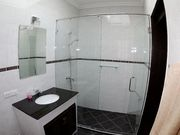 Windowed-bathroom 2. Hairdryer, shower gel and shampoo are provided.
