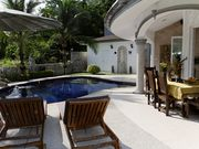 Enjoy your meals on the patio with a view of Thailand's nature.