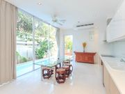 fully equipped kitchen with pool view