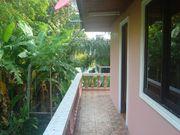 Large balcony surrounding the house