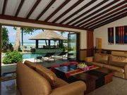 living room with pool and sea view