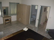 Main bedroom. Ensuite-Bathroom entrance.Large shower and hot water.
