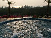 Enjoy the beautiful private roof-top jacuzzi while watching the sun go down.