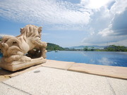 Infinity edge swimming pool overlooking Bang Tao Bay