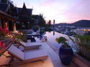 Terrace and pool at sunset over Surin bay