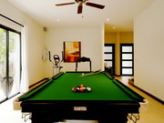 Games room with pool table, dart board and gym equipment....
