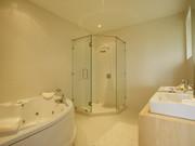 Bedroom 2's master bathroom with Jacuzzi bath