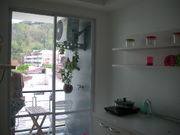 small kitchen which connect to balcony