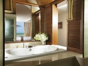 En suite bathroom with separate shower, 2 wash basins andseparate bath tub in the master bedroom