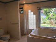 Jacuzzi and full bathroom facilities with tropical garden view!