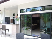 Front Entrance and outside bar on left for entertaining guests