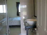 Spacious and modern bathroom facilities.