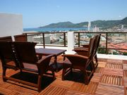 Furnished rooftop terrace with sea and mountain views