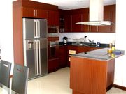 Kitchen with 4-door refrigerator, oven, microwave and 4-burner cooktop/hob.