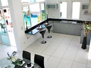Modern Western Kitchen Next to The Pool.Fitted with quality fixtures and appliances for people who love food.