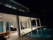 The terrace and swimming pool area in night time