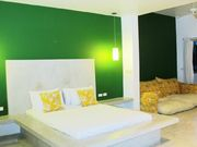 NATURE Bedroom's decoration in green mixed with golden yellow gives the fine blend of outside view