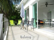 Balcony with sun chairs and chair/table