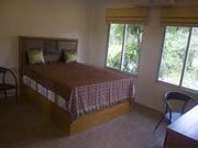 bedroom with high (senior) queenbed